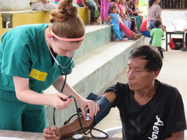 Pharmacy student taking blood pressure in the Triage station deep in the Amazon Jungle