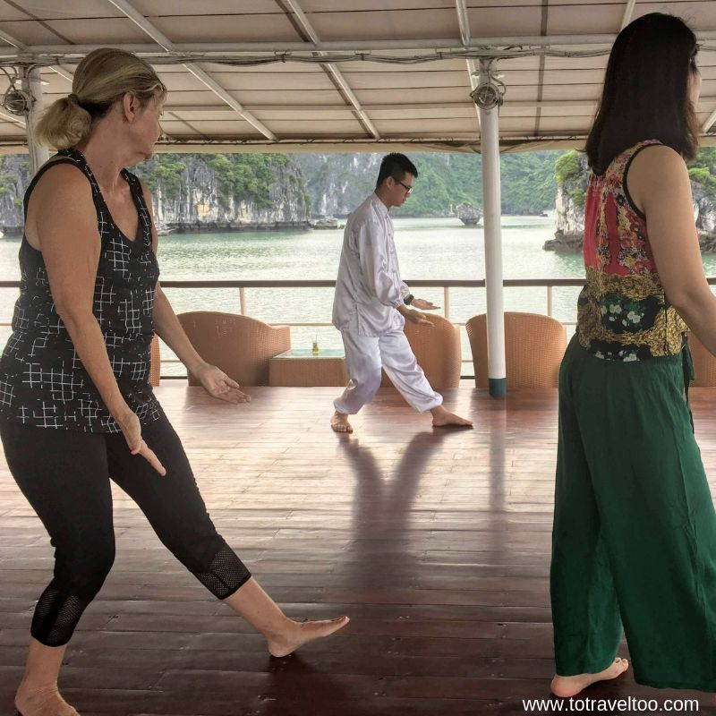 Tai Chi at sunrise on Emeraude 2 night cruise on Halong Bay