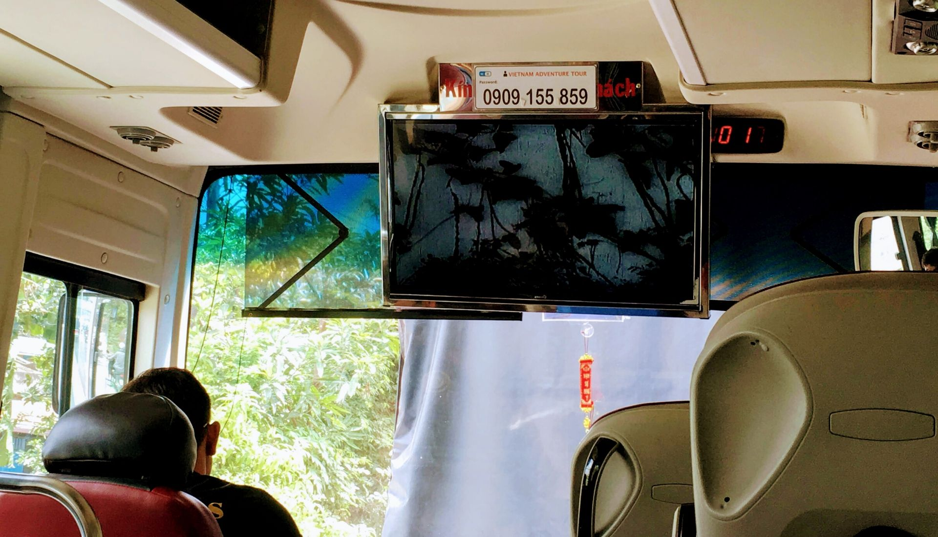 Watching the movie in the mini bus
